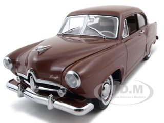 1951-kaiser-henry-j-with-trunk-caribbean-coral-platinum-edition-118-diecast-car-model-by-sunsta