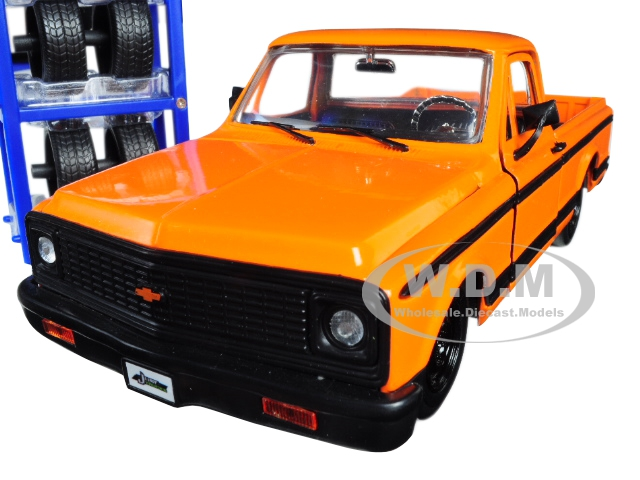 1972 Chevrolet Cheyenne Pickup Truck Orange with Black Stripes and Extra Wheels