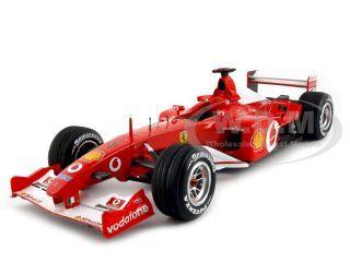 Ferrari_F2002_F1_1_Michael_Schumacher_France_2002_Elite_118_Diecast_Model_Car_by_Hotwheels