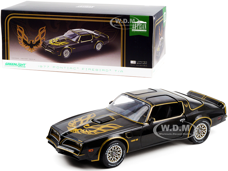 http://www.diecastmodelswholesale.com - 1977 Pontiac Firebird T/A Trans Am Starlite Black with Golden Eagle Hood 1/18 Diecast Model Car by Greenlight